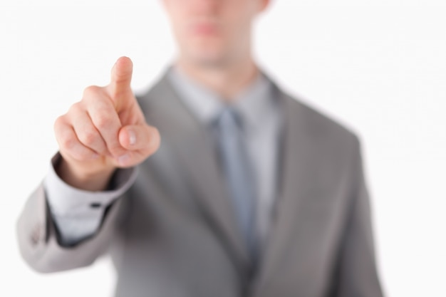 De hand van een zakenman wat betreft iets