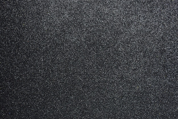 De hobbelige zwarte schittert geweven achtergrond, close-up