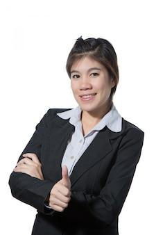De jonge mooie bedrijfsvrouw die duim op hand, bedrijfsconcept succes, goed werk tonen, keurt goed, goedkeurt, gaat akkoord en positief resultaat
