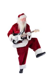 De kerstman heeft plezier met een gitaar