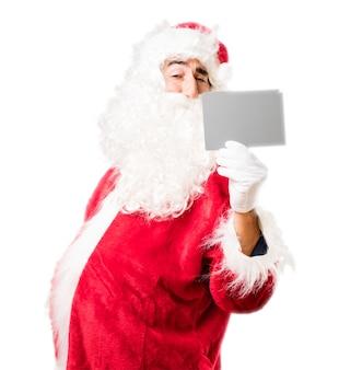 De kerstman met een witboek