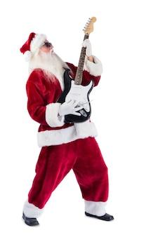 De kerstman speelt gitaar met zonnebril