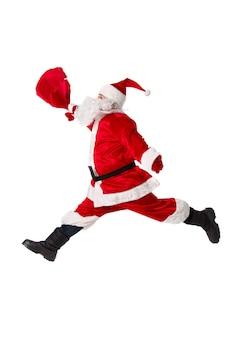 De kerstman springt. geïsoleerd op wit.