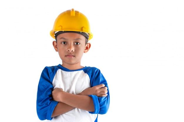De kleine jongen in een droom wil in de toekomst architect of ingenieur worden.