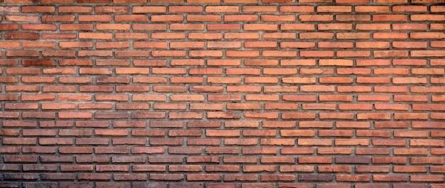 De kleurrijke bakstenen muur is een achtergrond van de bloktextuur