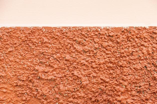De kleurrijke muur van de twee toon oranje pompoen voor achtergrond.