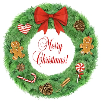 De kroon van kerstmis met decoraties geïsoleerd op een witte achtergrond
