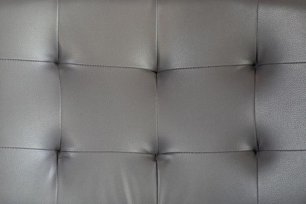 De leertextuur van het luxuyr beige bruine bank voor achtergrond