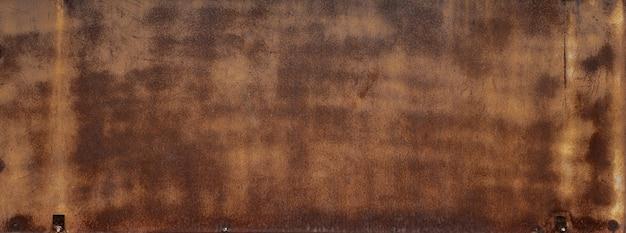 De lege bruine roestige textuur van het metaalstaal