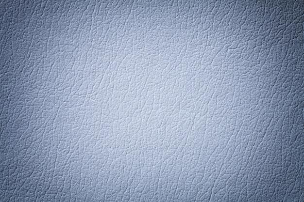 De lichtblauwe achtergrond van de leertextuur met patroon, close-up