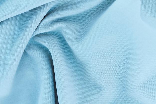 De lichtblauwe stof van de close-uptextuur van kostuum