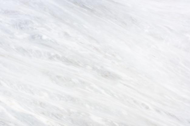 De lichtgrijze marmeren textuurachtergrond, luxe ziet tafelblad eruit.