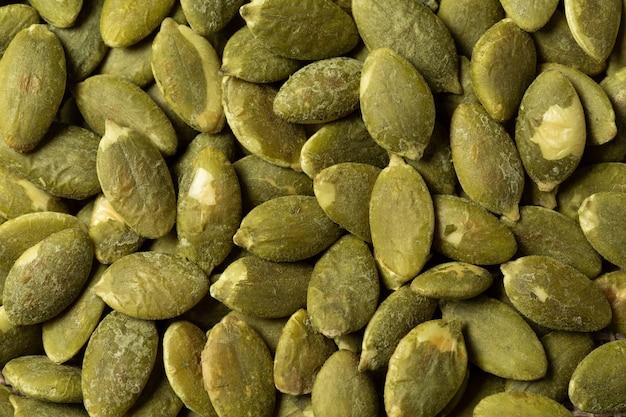 De macro groene textuur van pompoenzaden.