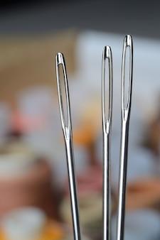 De macro van het drie naaiende naaldenoog