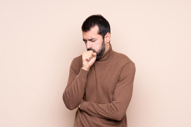 De mens over geïsoleerde achtergrond lijdt met hoest en voelt slecht
