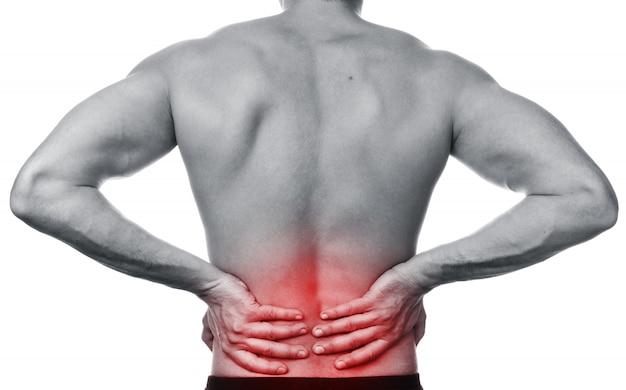 De mens voelt pijn in de rug
