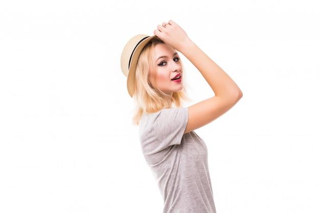 De mooie vrouw in heldere hoed kijkt op u