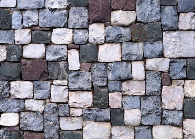 De muurtextuur en achtergrond van de steen