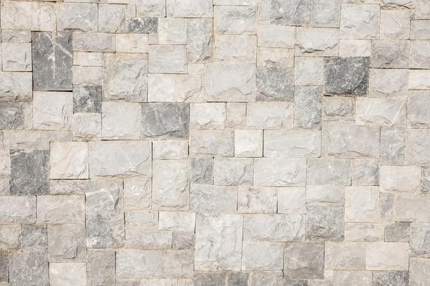 De muurtextuur van de steen voor achtergrond.