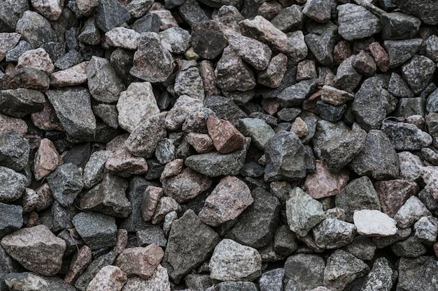 De natuurlijke close-up van de verpletterde steentextuur