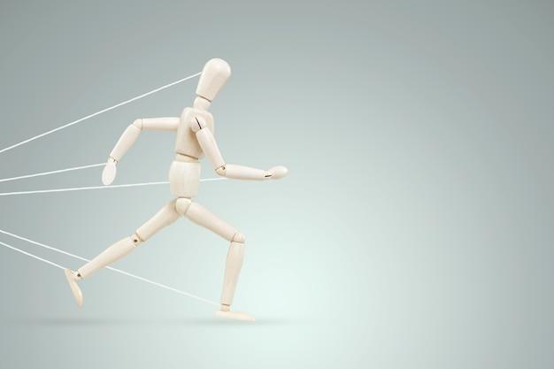 De neon marionet gebonden over de benen en armen vecht en verzet zich. zakelijke moeilijkheid of worsteling met het concept van loopbaanobstakels, bureaucratie