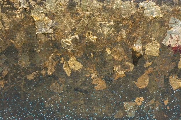 De oppervlakte van gouden plaat voor sluit het standbeeld van boedha, textuur en achtergrond