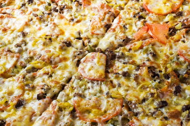 De oppervlaktetextuur van de pizza. detailopname.