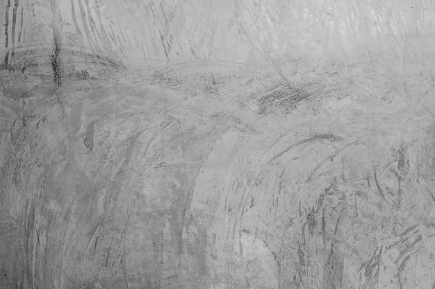 De oppervlaktetextuur van het muurcement van de concrete, grijze concrete achtergrond van het achtergrondbehang
