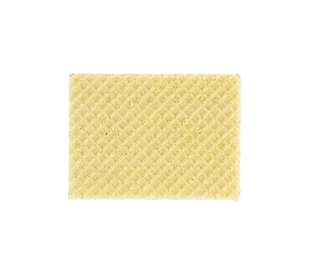 De oppervlaktetextuur van wafels geïsoleerd op een witte achtergrond. verse zelfgemaakte taarten.