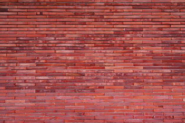 De oranje achtergrond van de bakstenen muurtextuur. vintage patroonbehang. lege bakstenen muur. oranje schaduw brickwall achtergrond. home muur interieur. oranje muur van het huis.