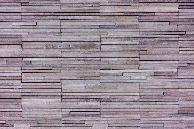 De oranje grijze muur van rotslagen voor textuurachtergrond