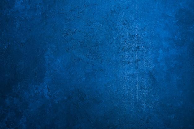 De oude achtergrond van de steentextuur stemde klassieke blauwe kleur