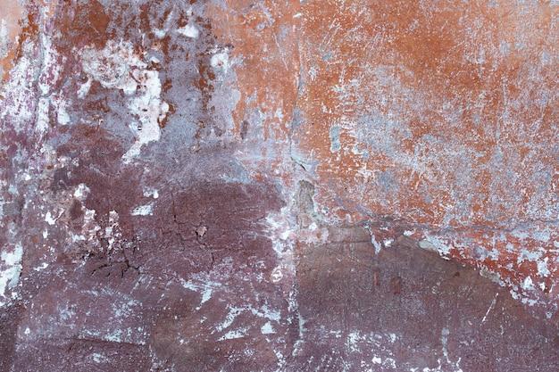 De oude beschadigde gemengde kleur van de muurtextuur
