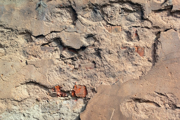 De oude beschadigde ruwe textuur van de de bouwmuur