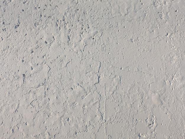 De oude betonnen muur is grijs. steen textuur voor ontwerp. hoge kwaliteit foto