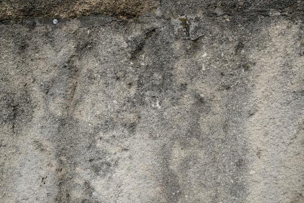 De oude concretegrunge beschimmelde achtergrond van de muurtextuur
