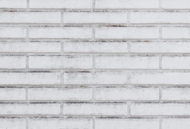De oude grijze achtergrond van de bakstenen muurtextuur