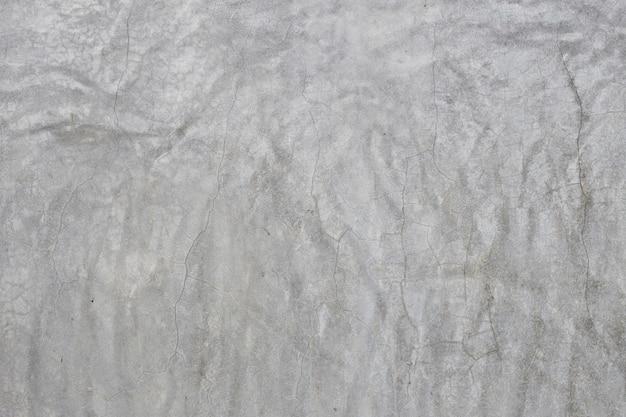 De oude grijze muur brak beton