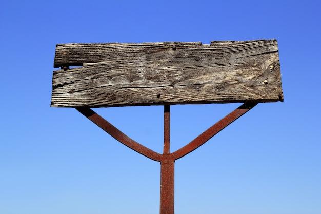 De oude houten uitstekende spatie van het tekensignaal copyspace