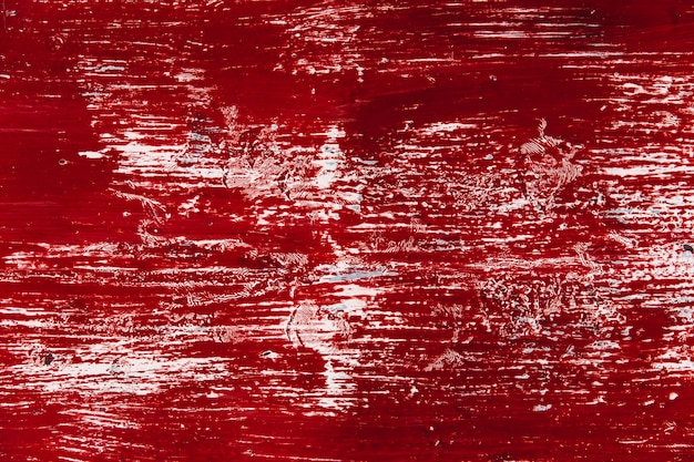 De oude muur met vuile verf rode kleur kijkt als bloed grunge wrijft de achtergrond van de vlektextuur