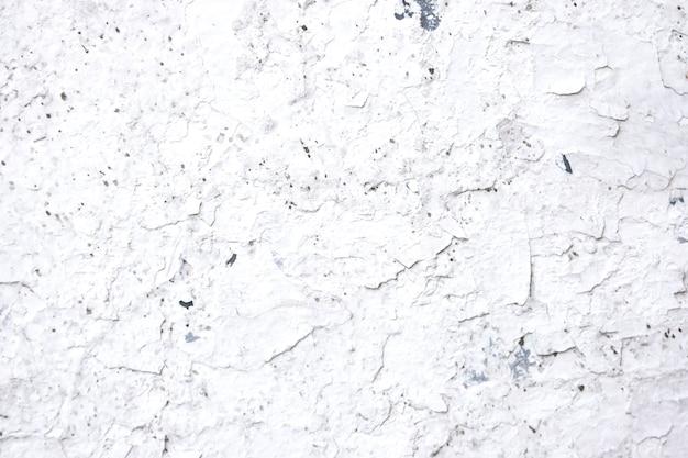De oude witte achtergrond van de muurtextuur