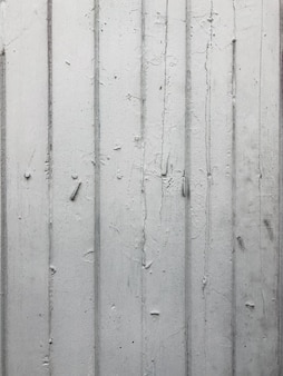 De oude witte houten achtergrond met de spijker erin.