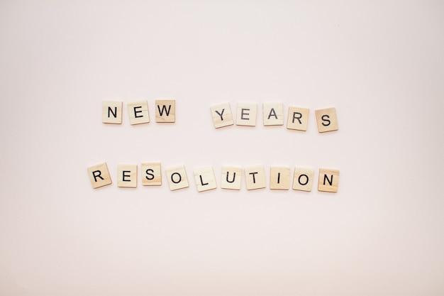 De resolutie van het inscriptie nieuwe jaar van houten blokken