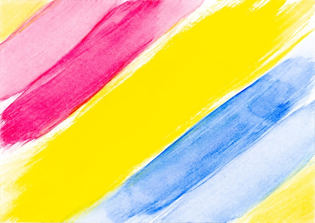 De rode gele en blauwe abstracte slag van de waterverfborstel op witte achtergrond.