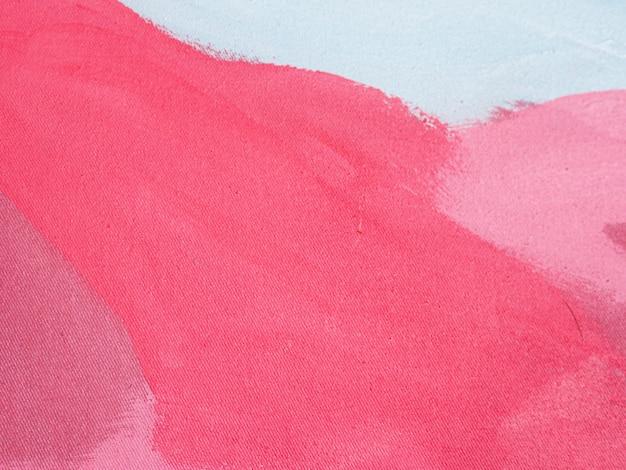 De rode slag van de olieverfschilderijborstel op canvas abstracte achtergrond en textuur