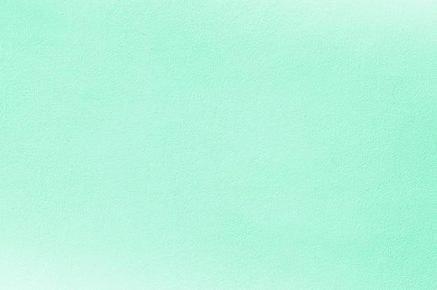 De romantische bleekgroene textuur van de cementmuur - pastelkleur