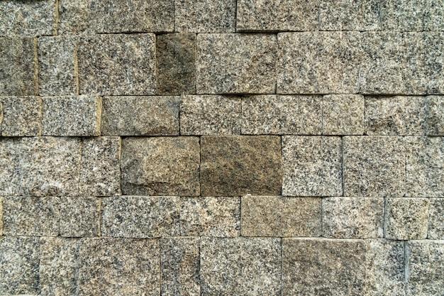 De rotstextuur van de baksteen voor achtergrond