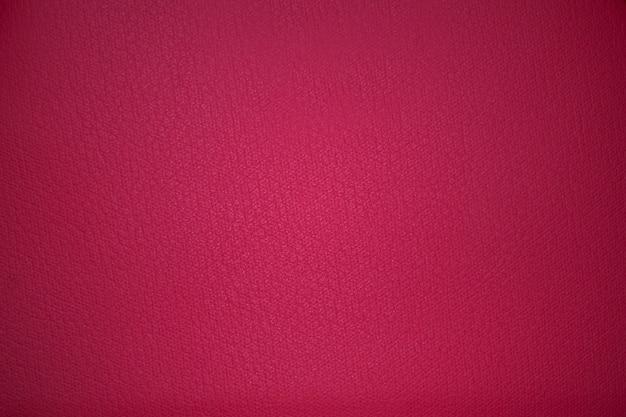De roze achtergrond van de stoffentextuur met vignetting