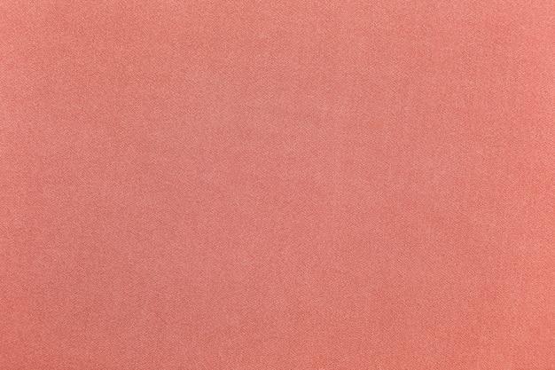 De roze grungy achtergrond van de muurtextuur met exemplaarruimte