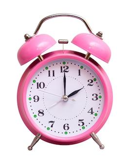 De roze klok op een witte geïsoleerde show 2 uur